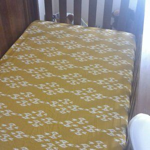 Like new crib sheet in pea green ikat